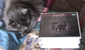 Smudge does not snuggle books, even really good ones.