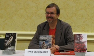 David Lee Summers giving a reading.