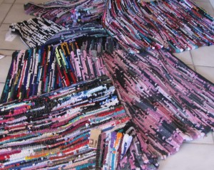 Here is a pile of sock rugs. Yep, lots & lots of socks were mutilated in the making of these rugs.